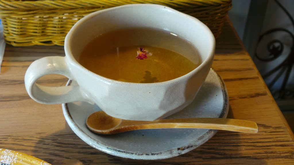 Tea with a cute detail, a small rose