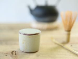 Small lidded container in matt cream