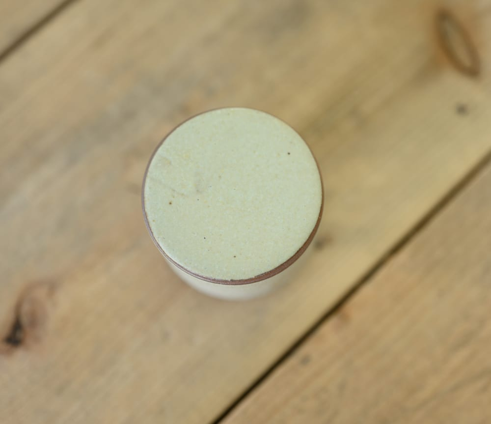 Small lidded container in cream