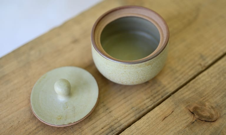 small lidded container
